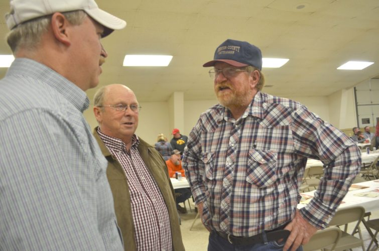 -Messenger photo by Kriss Nelson Bruce Long, Webster County Cattlemen's Association president, right, visits with volunteer auctioneers Dan Vonnahme, center, and Scott Klingson, after the trophy auction at the Webster County Cattlemen's Association banquet.