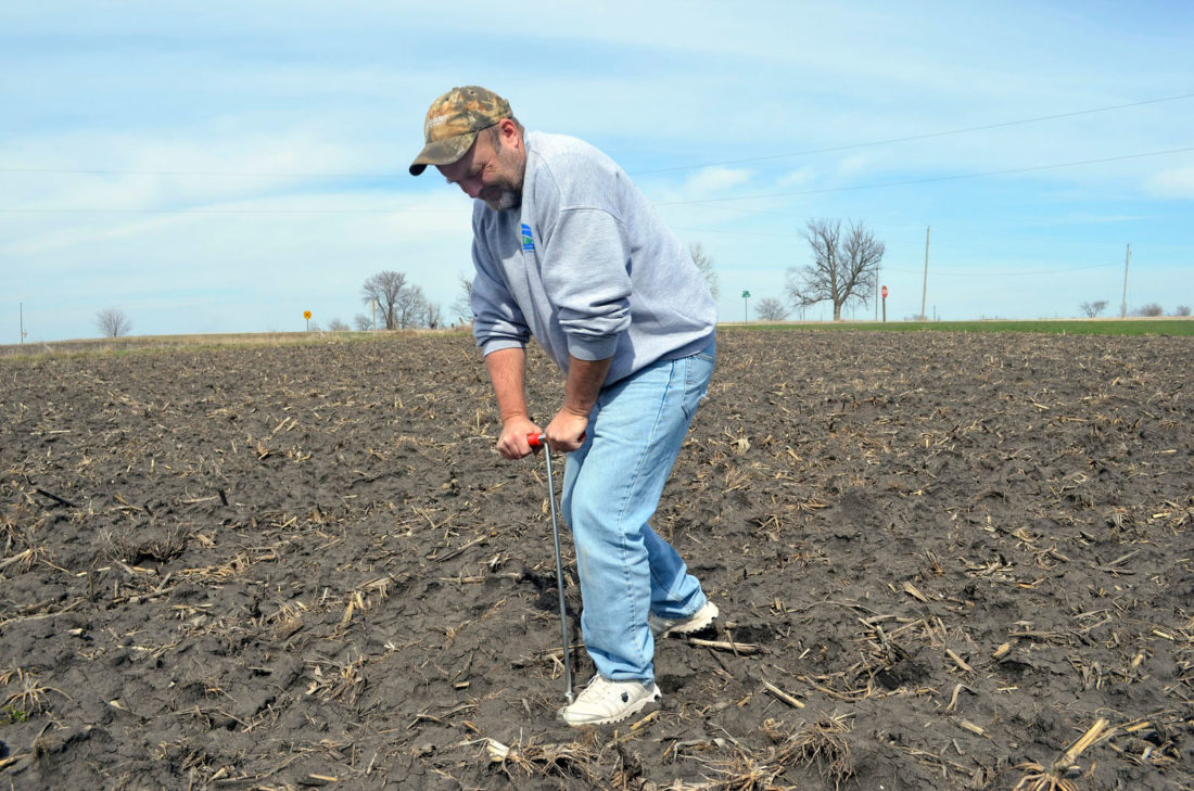 -Messenger photo by Kriss Nelson Brent Johnson, owner of Labre Crop Consulting, takes some spring soil samples last week on his farm near Manson. Johnson said there is plenty of time for producers to get their field's fertility checked through soil sampling.