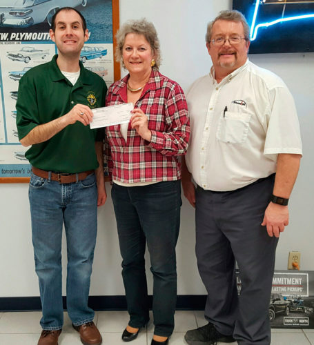 Knights of Columbus Council 613 in Fort Dodge presented a check for $1,000 to Liz Rusher, director of North Central Area Special Olympics. Pictured from left are Tony Schulte, Rusher and Brian Decklau.