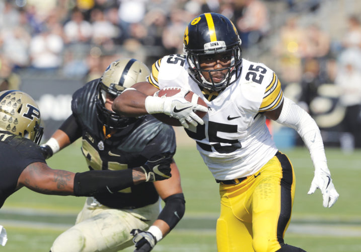 AP Photo  Iowa's Akrum Wadley runs the ball against Purdue in Lafayette, Ind. last season.