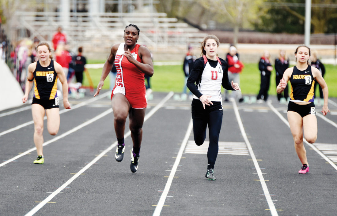 Messenger photo by Britt Kudla  Car'Maiya Mosley of Fort Dodge takes the lead in the 100-meter dash on Thursday during the Dodger Relays. For more photos, please visit CU.messengernews.net