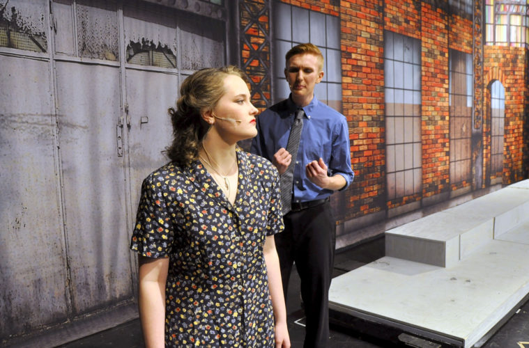 -Messenger photo by Joe Sutter  Lead actors Olyvia Selby, left, and Collin Ellsbury, both sophomores, run through a scene before rehearsal of Fort Dodge Senior High's production of 'The Pajama Game'. Every musical romance starts in conflict, especially when the leader of the workers' grievance committee falls for the new factory superintendent.