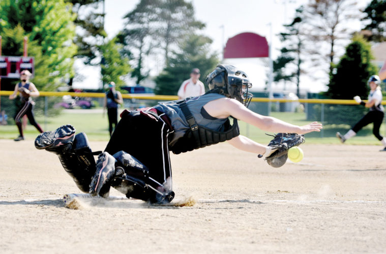 Messenger photo by Britt Kudla   A player dives for a ball during a 12U youth softball tournament at Rogers Park last season.