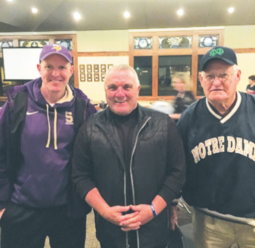 —Submitted photo  Jim Tighe (left) and Dick Tighe (right) stand with Rudy Ruettiger at a convention in Spencer this past weekend. Ruettiger, who was a walk-on at Notre Dame is best known for the movie Rudy, which is based on his life.