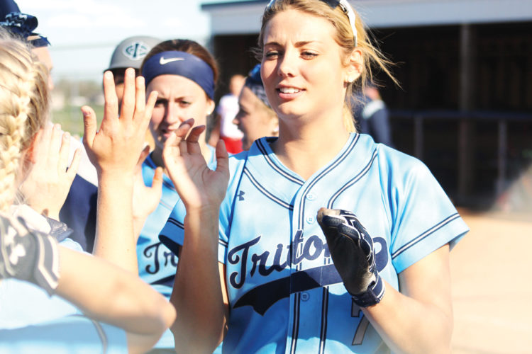 Photo by Kirk Hardcastle, for The Messenger  Maddie Wagner and her Triton teammates celebrate their win on Tuesday over Northeast in Boone.