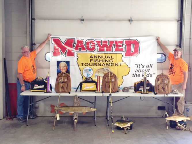 —Submitted photo  Jeff Burke (left) and Jeff Woods (right) stand with the trophies for the youth and adult divisions of the MAGWED fishing tournament.