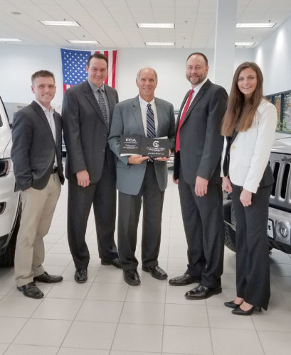 Shimkat Motor Co. recently received the Customer First Award of Excellence from Fiat Chrysler of America. The company is one of four dealerships in the state of Iowa to receive this award. Shimkat will celebrate 70 years with an open house and ribbon cutting on June 13, beginning at 5 p.m. Pictured from left are Dan Lausas, Bill Shimkat, Bruce Shimkat, Ed Shimkat and Marissa Bronowicki.