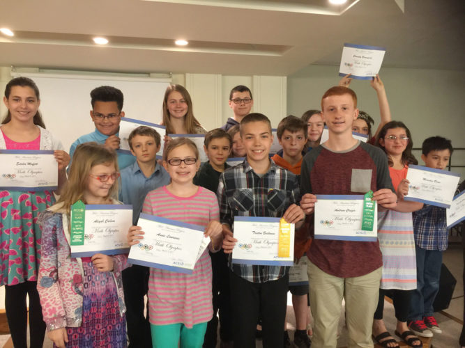 Community Christian School hosts a Math Olympics competition through the Association of Christian Schools International each year.  Participants must qualify and are competing with students from other Christian schools in the ACSI district.  The students pictured in front placed in the competition. From left are Aliyah Carlson, Annie Lawrence, Triston Bockoven and Andrew Creger. Qualifiers are pictured in the second row: Anthony Pollash, Levi Odor, Jayne Macek, Sam Halbach, Mercedes Boone and Kenneth Grey. Qualifiers are pictured in the back row: Estella Moffitt, Leon Cook, Reagan Black, Seth Henrickson, Destiny Countryman and Serenity Brownfield.