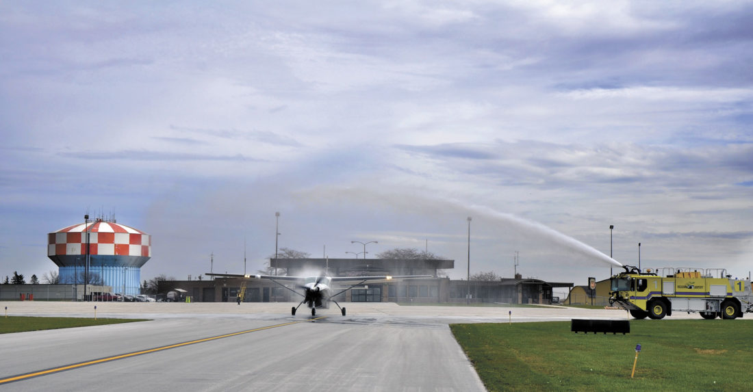 -Messenger file photo by Joe Sutter  Water sprays off the plane's propeller as a water cannon salute douses the first flight out of Fort Dodge Regional Airport bound for Minneapolis/St. Paul in March.