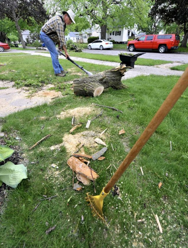 -Messenger photo by Hans Madsen  Scott Sanders, of Des Moines, uses a trimming saw to cut up the last section of a large tree branch that fell on his mother's home in the 2000 block of Third Avenue North. Pat Sanders said she was grateful the limb didn't cause more damage than it did.