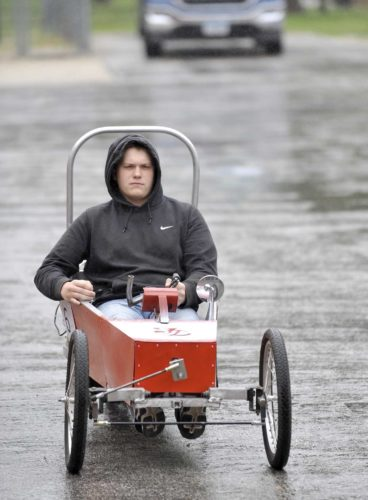 -Messenger photo by Hans Madsen  Fort Dodge Senior High student Noah Nafe takes the Ultimate MPG class's vehicle out for a test spin Friday afternoon. The moped motor powered car achieved 96 mpg in testing at the recent SE Polk Industrial Tech Expo which placed the team at 11th place.