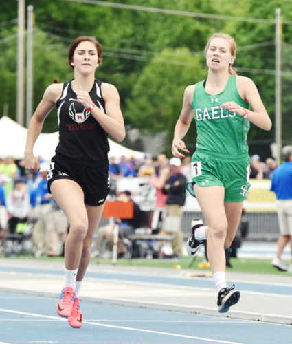Messenger photo by Britt Kudla  Megan Flattery of St. Edmond competes in the 400-meter dash at the state track meet in Des Moines.
