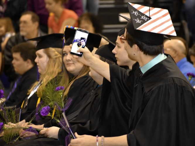 -Messenger photo by Chad Thompson  Austin Burgwin, 18, front, gets in a selfie during the Eagle Grove Community High School commencement Sunday afternoon.
