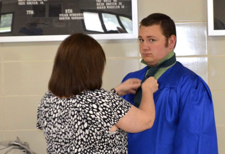 Messenger photo by Bill Shea  Drake Petersen gets some help with his necktie from his mother, Michelle Kraft, Sunday afternoon prior to the Humboldt High School graduation.