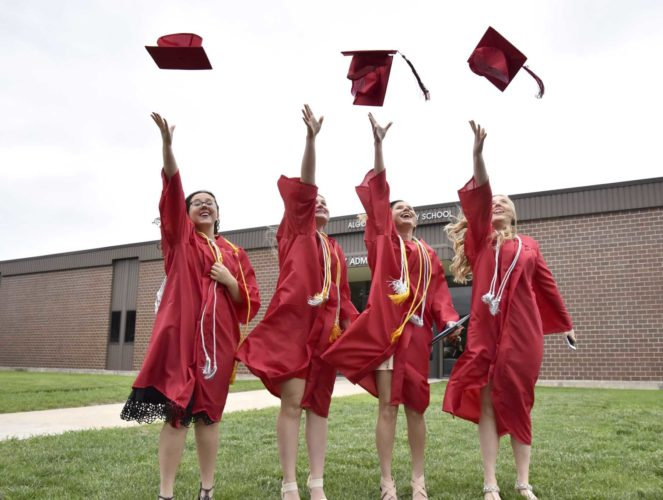 -Messenger photo by Britt Kudla Algona 2017 graduates (left to right) McKinnley Long, Cophie Curtis, Halie Bleich, and Jadi Reding toss their hats into the air after graduation on Sunday.