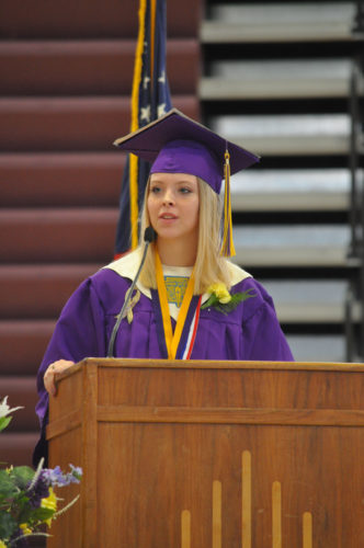 -Messenger photo by Adri Sietstra Webster City High School Senior Josie Asklund addresses her classmates and a filled gymnasium Sunday afternoon during WCHS commencement exercises.