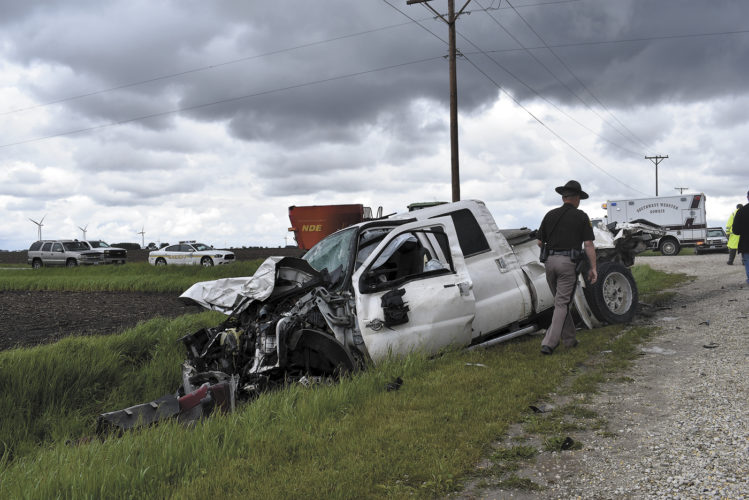 -Messenger photo by Chad Thompson  Trooper Justin Parman, of the Iowa State Patrol, walks away from a pickup truck involved in a collision near Gowrie Tuesday afternoon. Mitch Pearson, 40, of Moorland, was driving the truck. He was transported with non-life-threatening injuries to UnityPoint Trinity Regional Medical Center, according to Tony Walter, Webster County sheriff's deputy. The truck collided with a semitrailer carrying a load of corn at the intersection of 310th Street and Johnson Avenue. Don Sandel, 66, of Fort Dodge, was driving the semitrailer. Sandel was treated on scene, but not transported to a hospital. The Iowa State Patrol, Webster County sheriff's deputies, Southwest Webster Gowrie Ambulance, and Gowrie volunteer fire department were on scene.