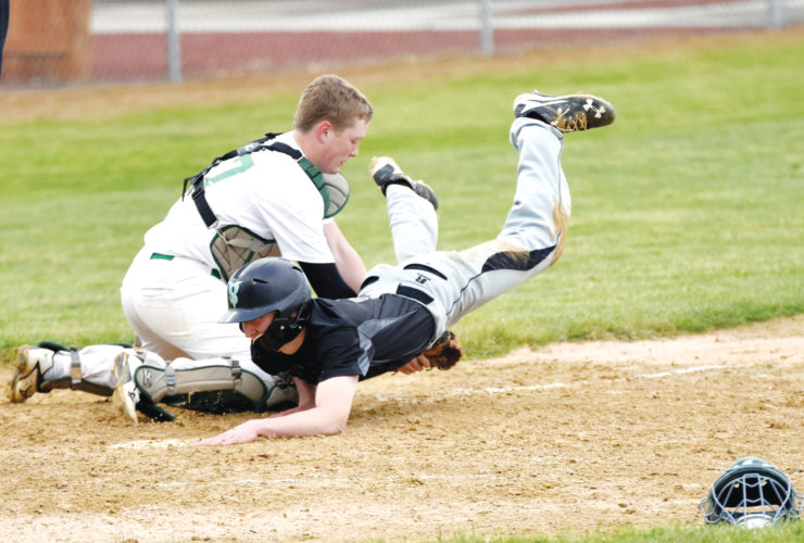 -Messenger photo by Britt Kudla Jack McEvoy of St. Edmond tags out Southeast Valley Nolan Johnson on Tuesday at Rogers Park