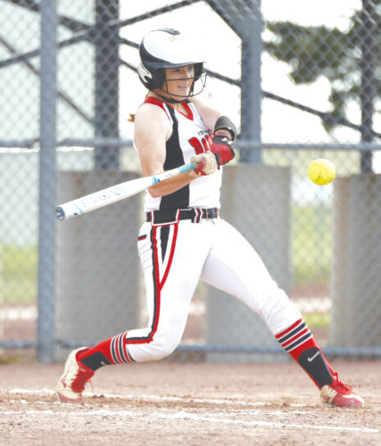 -Messenger photo by Britt Kudla Maggie Harvey of Fort Dodge connects for an RBI double against Des Moines Roosevelt on Friday