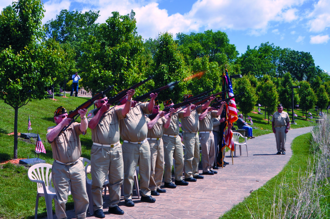 -Messenger photo by Bill Shea  The color guard from Veterans of Foreign Wars Post 1856 in Fort Dodge fires a rifle salute at the conclusion of Monday's Memorial Day ceremony at Veterans Memorial Park. About 200 people attended.