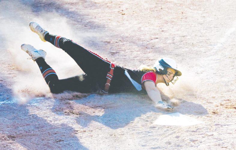 -Messenger photo by Britt Kudla Loghen Schnetzer of Fort Dodge slides into home against Marshalltown on Tuesday
