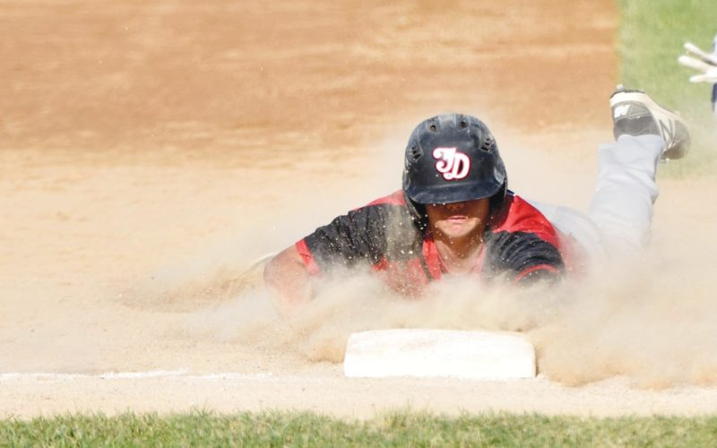 -Messenger photo by Britt Kudla Drake Miller of Fort Dodge steals third against Des Moines North on Wednesday at Ed McNeil Field
