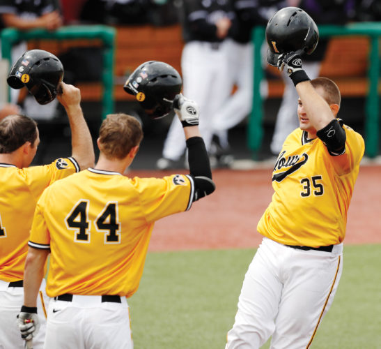 Photo by Brian Ray, Iowa Media Relations  Iowa's Jake Adams (35) is greeted after hitting his 27th home run this season during the Big Ten Tournament.