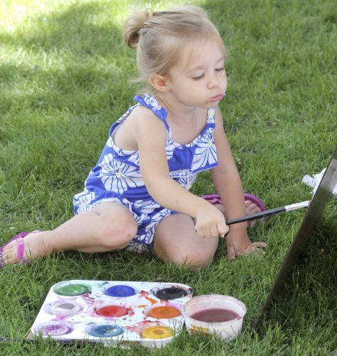 -Messenger photo by Hans Madsen  Josie Laufersweiler, 2, of Fort Dodge, concentrates on her brush strokes Saturday morning during the Blanden Memorial Art Museum Summer Arts Festival. Painting was one of several activities for budding young artists to try out.