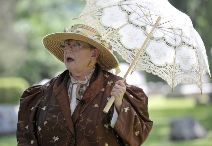-Messenger photo by Hans Madsen  With an nice parasol to help keep her cool, Ruth Bennett portays Cornelia Bagg, 1821-1896, during the 14th annual Oakland Cemetery Walk Saturday afternoon. Bagg's husband designed the cemetery but is ironically, buried at sea.