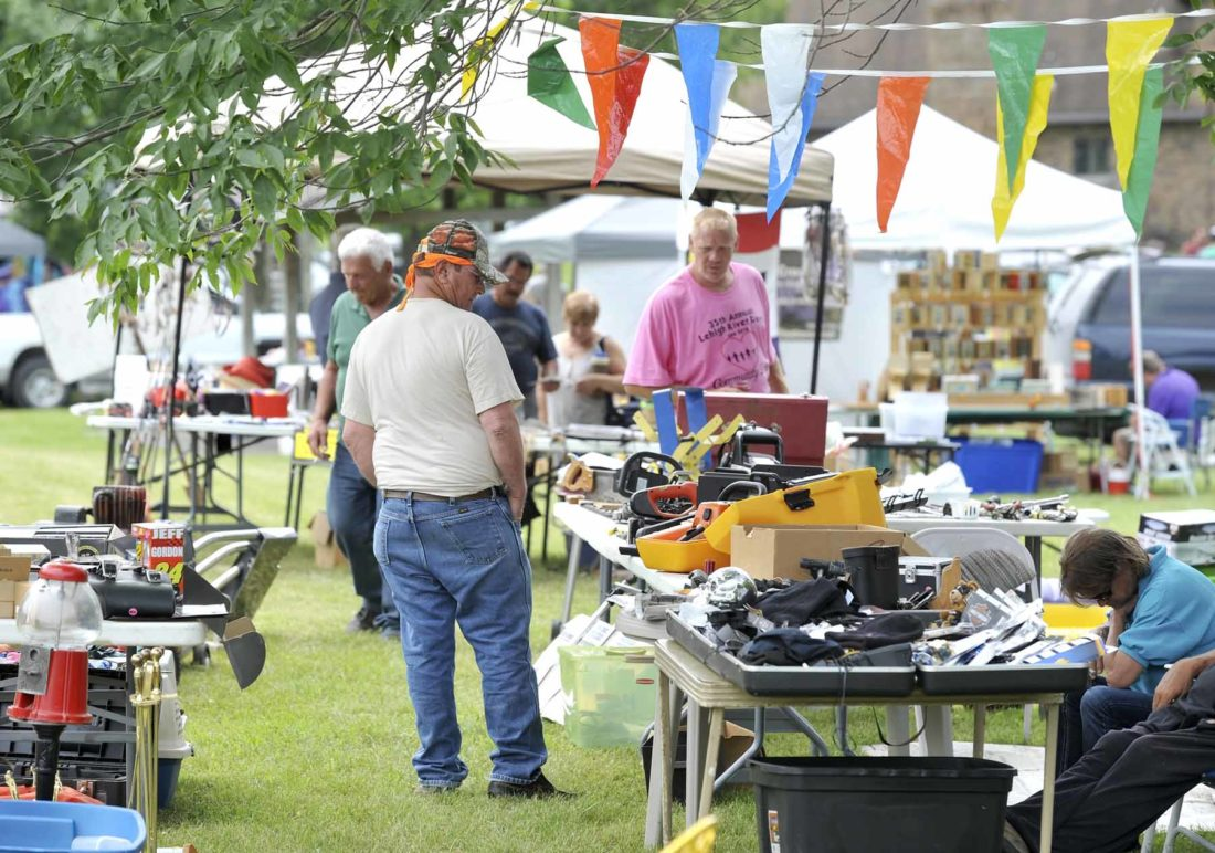-Messenger photo by Hans Madsen  Jimmie Hurley, of Fort Dodge, looks for bargains among the vendors at the 2016 Lehigh River Days flea market. Other events included mud volleyball and a log rolling competition.