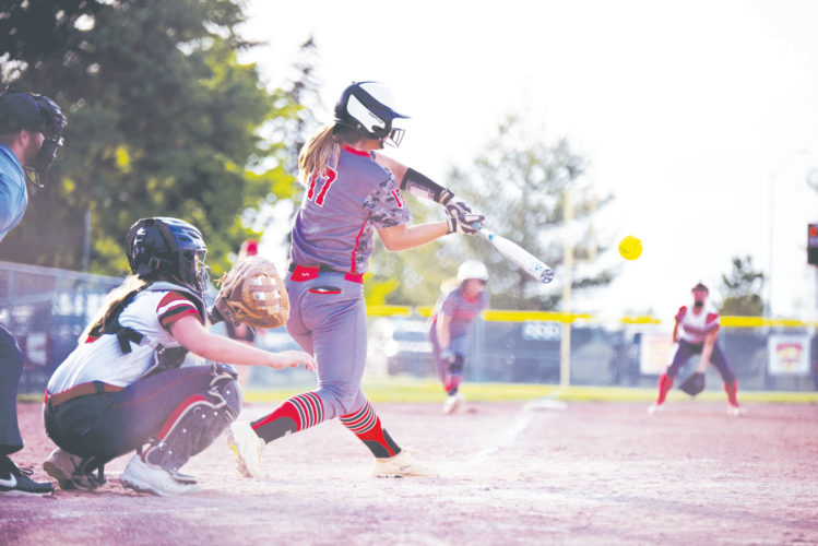 -Messenger photo by Britt Kudla Loghen Schnetzer of Fort Dodge hits a three run homer against Mason City on Wednesday at Rogers Park