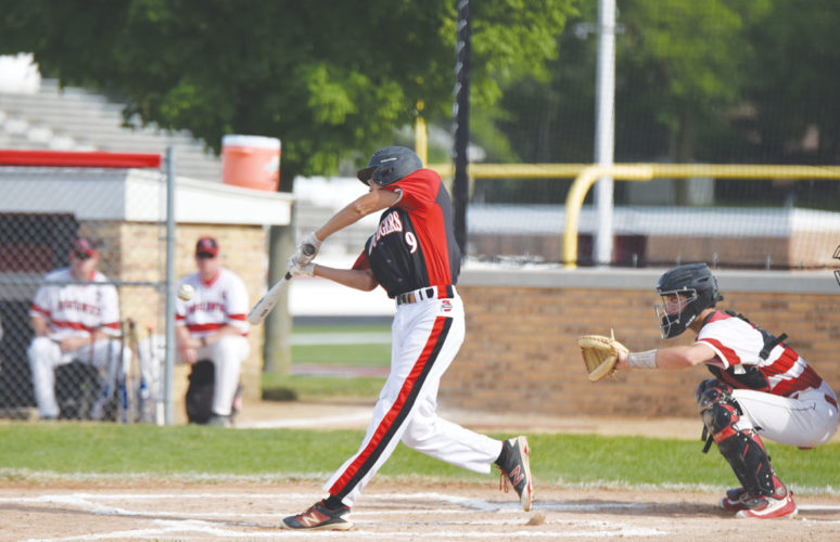 -Messenger photo by Britt Kudla Nate Scherff of Fort Dodge connects for a double against Mason City on Wednesday at Ed McNeil field