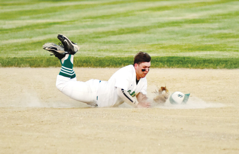 Messenger photo by Britt Kudla  Jake Szalat makes a diving catch for St. Edmond against Clarion-Goldfield/Dows on Friday at Rogers Park. For more photos, please visit CU.messengernews.net