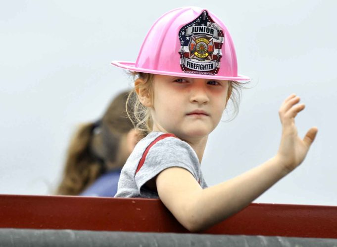 -Messenger photo by Hans Madsen  Lexi Groat, 6, of Badger, modeled the latest in pink firefighting gear as she rode on one of the Badger Fire Department's trucks during a previous Badger Fest parade.