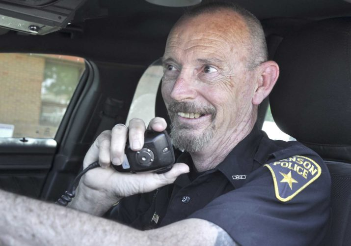 -Messenger photo by Peter Kaspari  Manson Police Chief Tom Ritts takes a call on his radio in his squad car. Ritts, who has been Manson's police chief since 1997, is retiring at the end of the month after a 42-year career in law enforcement.