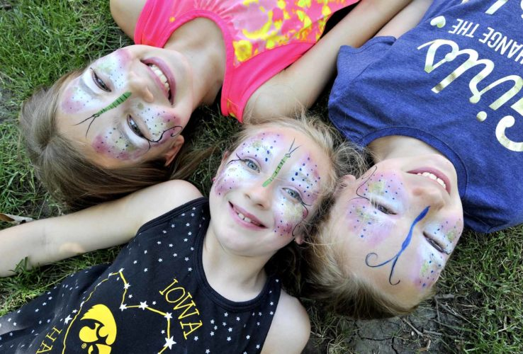 -Messenger photo by Hans Madsen Above: Sisters Emma Crawford, 11, at left, and Hayley Crawford, 9, right, both of Moorland, show off their nearly identical butterfly face paintings with their cousin, Kylee Burris, 8, of Duncombe, center during the annual Blanden Summer Art Festival at the Blanden Memorial Art Museum.