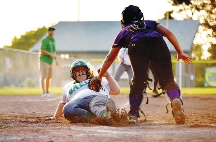 Messenger photo by Britt Kudla  Sydney Nelson of St. Edmond slides safely into home against Eagle Grove on Tuesday evening at Rogers Park. For more photos, please visit CU.messengernews.net