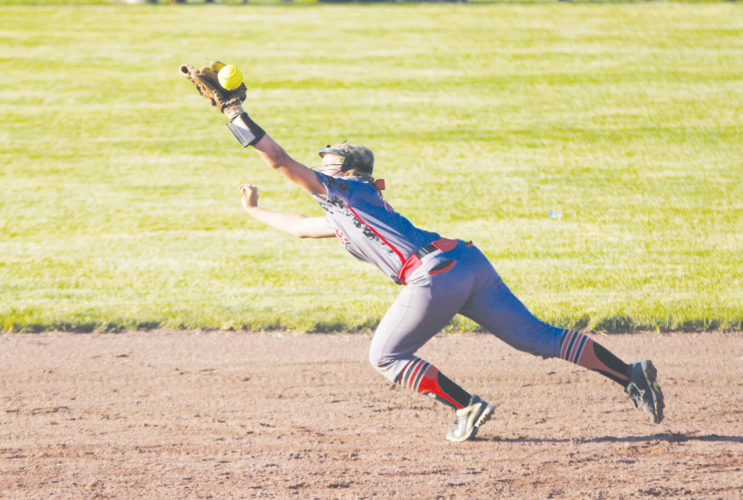 -Messenger photo by Britt Kudla Tristin Doster of Fort Dodge makes a diving catch against Johnston on Wednesday at Rogers Park