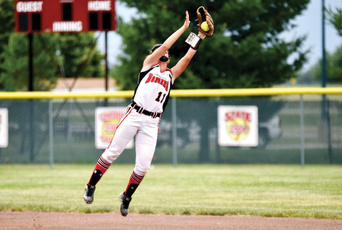 Messenger photo by Britt Kudla  Tristin Doster of Fort Dodge makes a catch against Harlan at Rogers Park on Friday during the Fort Dodge Invitational. For more photos, please visit CU.messengernews.net