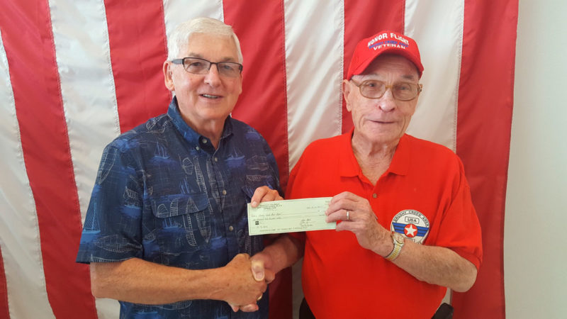 The Knights of Columbus Council 613 has set up a donation table to raise money for the Brushy Creek Area Honor Flights at the Knights of Columbus Lenten Fish Fry for two years in a row. This money is used to send veterans to the World War II, Korean, Vietnam and Iwo Jima memorials and Arlington Cemetery in Washington, D.C., to honor their service. Pictured are Ron Newsum of Honor Flight receiving a check for $1,200 from Ray Crouse of Council 613. Crouse set up a table at each of the Fish Fry events and accepted donations and handed out pamphlets and applications for the flight.