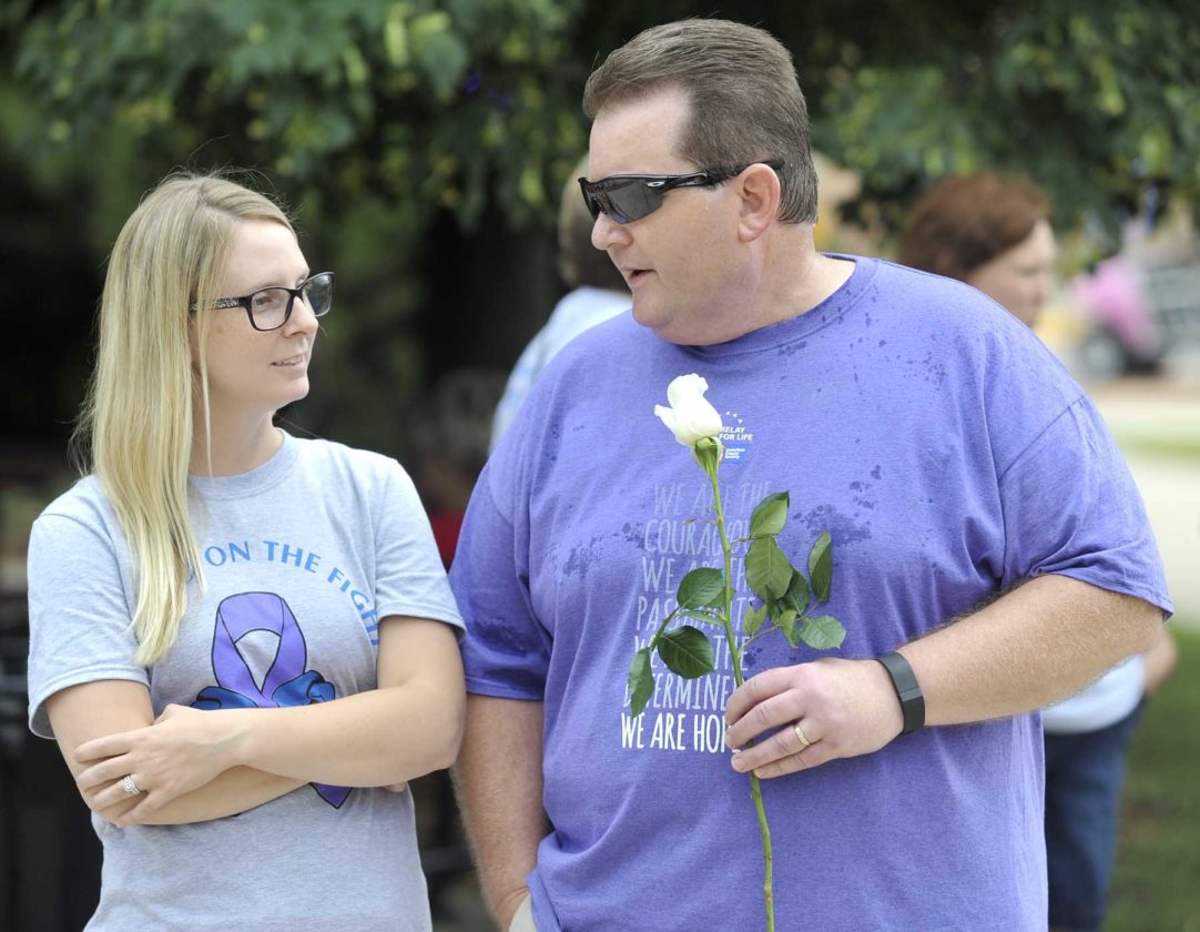 -Messenger photo by Hans Madsen  The 2017 American Cancer Society Relay for Life of Webster County Honoray Survivor, Duane Amhoff, of Fort Dodge, chats with Christen Sewell, of Badger, during the event held on the Fort Dodge City Square. Sewell manages the Trinity Cancer Center and helped treat Amhoff.