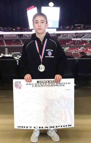 Submitted photo  Fort Dodge's Drake Ayala stands with his AAU state folkstyle championship bracket earlier in the year in Des Moines.