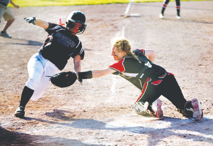 -Messenger photo by Britt Kudla Maggie Harvey of Fort Dodge makes the tag against Dowling on Wednesday at Rogers Park