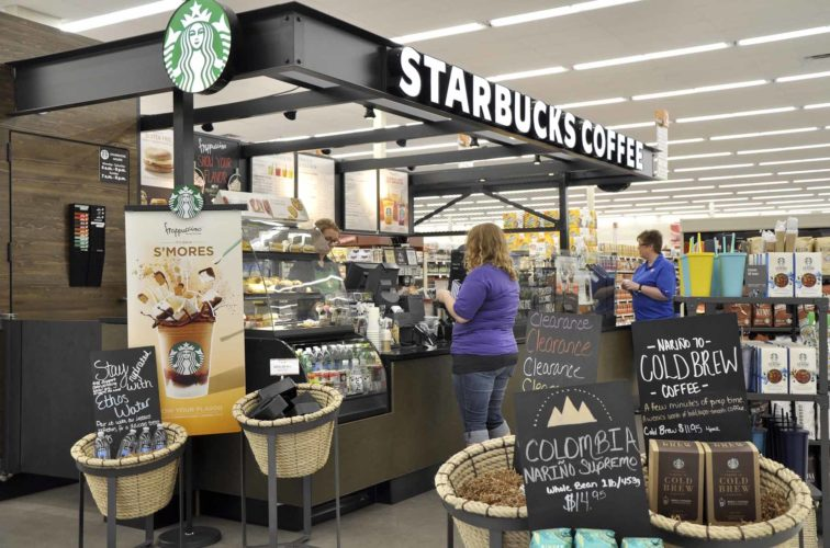 -Messenger photo by Joe Sutter  The Starbucks at Hy-Vee is busy on a recent morning. Hy-Vee manager Tim Flaherty said the kiosk has 12 to 15 employees who work throughout the week.