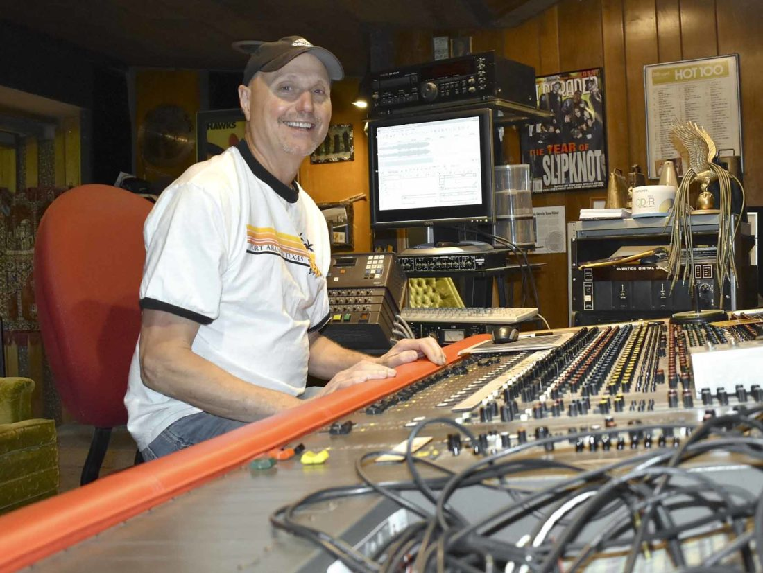 -Messenger photo by Chad Thompson  Kirk Kaufman sits in his recording studio at Juniors Motel, one mile outside of Otho, recently. Kaufman is a member of the band HAWKS. The band is playing at Shellabration July 8.