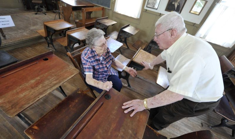 "-Messenger photo by Hans Madsen  Ralph Sonnicksen, of Fort Dodge, visits with Agnes Mumper, of Lehigh, inside the Border Plain School at the Fort Museum and Frontier Village Saturday during a reunion for former students. Mumper was a teacher at the school from 1940 to 1944. Now 96, she was 19 when she started teaching there. She taught the full slate of students from kindergarten of eigth grade. ""You had to do your homework,"" she said. ""All those papers to check."" When she taught there, the building was heated with wood. ""There was a wood stove where the piano is now,"" she said. ""I had to take care of the stove though the kids loved to do that, they loved to bring the wood in.  Sonnicksen was a student there from 1947 to 1956. ""We had a good time,"" he said. ""You heard all the classes lessons. If you didn't get it one year you got it the next."" Many of the former students, includiing Don Roosa, of Lehigh, recalled that school was situated so that students had to walk uphill both ways. ""Absolutely,"" Roosa said with a wink."