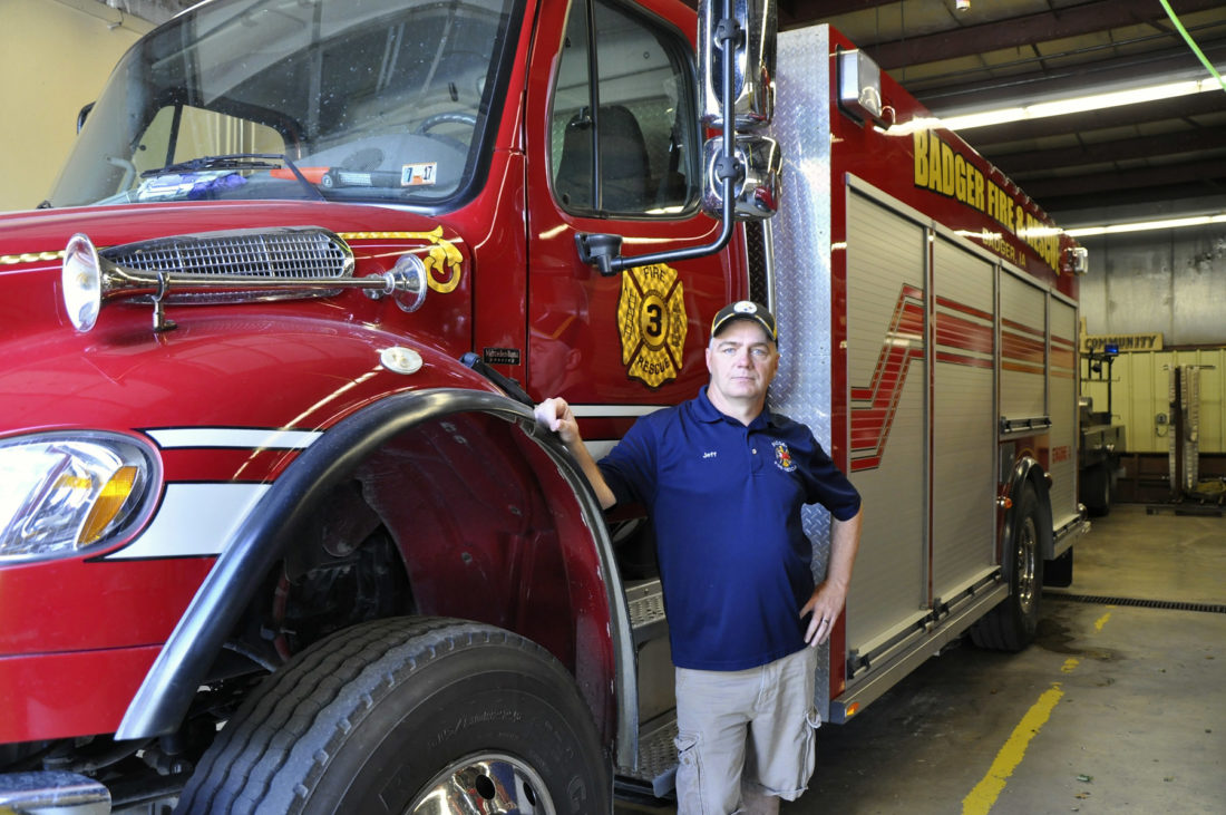 -Messenger photo by Joe Sutter  Fire Chief Jeff Brundige poses with the newest fire truck in Badger's fleet. It's not your imaginationÑthis Freightliner is a little taller than your average small-town pumper. The truck was formerly used in Pennsylvania in the mountains, and has four-wheel drive.