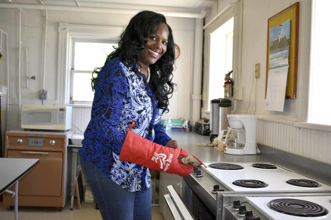 -Messenger photo by Chad Thompson  Sherry Washington, of Fort Dodge, prepares some food at Coppin Chapel African Methodist Church recently. Washington said her parents taught her at a young age that she should always make herself available to serve.