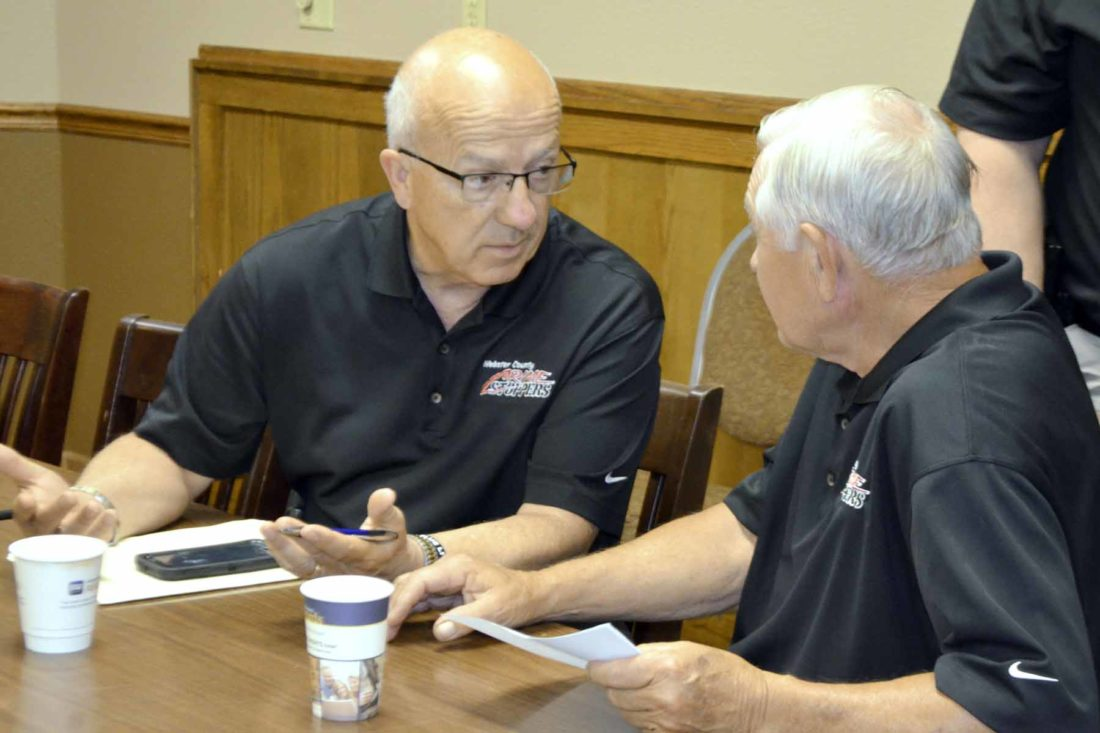 -Messenger photo by Peter Kaspari  Fort Dodge Police Chief Kevin Doty, left, speaks with Webster County Crime Stoppers board member Joe Condon following a recent board meeting.