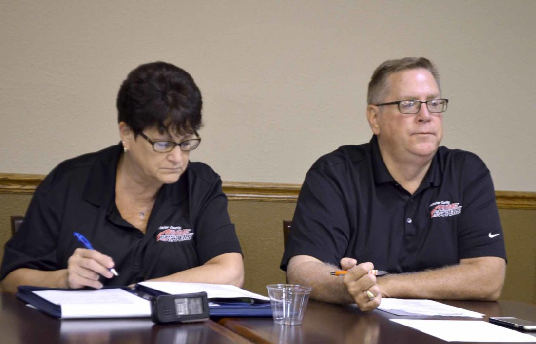 -Messenger photo by Peter Kaspari  Webster County Crime Stoppers President Dan Streit, right, listens while board secretary Sandy Markey, left, takes notes during a recent board meeting in Fort Dodge. Crime Stoppers has been a part of Webster County for nearly 35 years.
